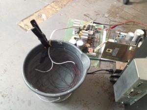 Using a bucket of water and magnet wire as a load for the +5.2V rail.