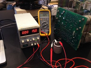 Testing capacitors to see if any need reforming.